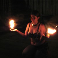 Sarah Davis holds fire during a dancing performance at Sub Rosa.