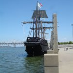 A replica of the Pinta is docked alongside the Wharf.