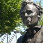 A statue of Lincoln looks upon the Ohio River.