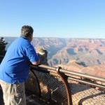 My father takes in the view of Grand Canyon.