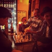 My friend Dillon plays chess at the Black Cat Hostel in Antigua, Guatemala.