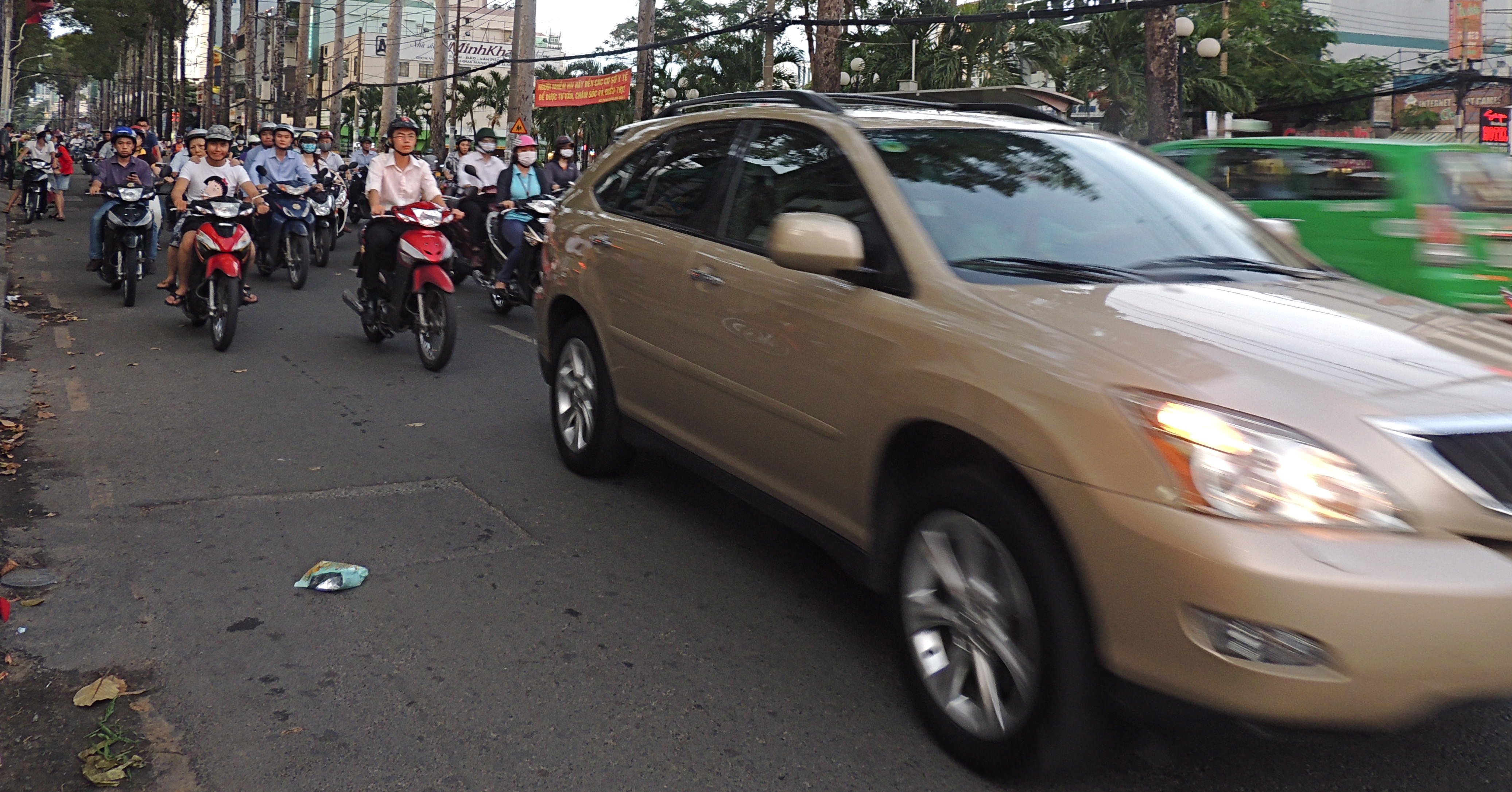 Cars are a rarity on the roads. Motorbikes are the more immediate concern when crossing the street.