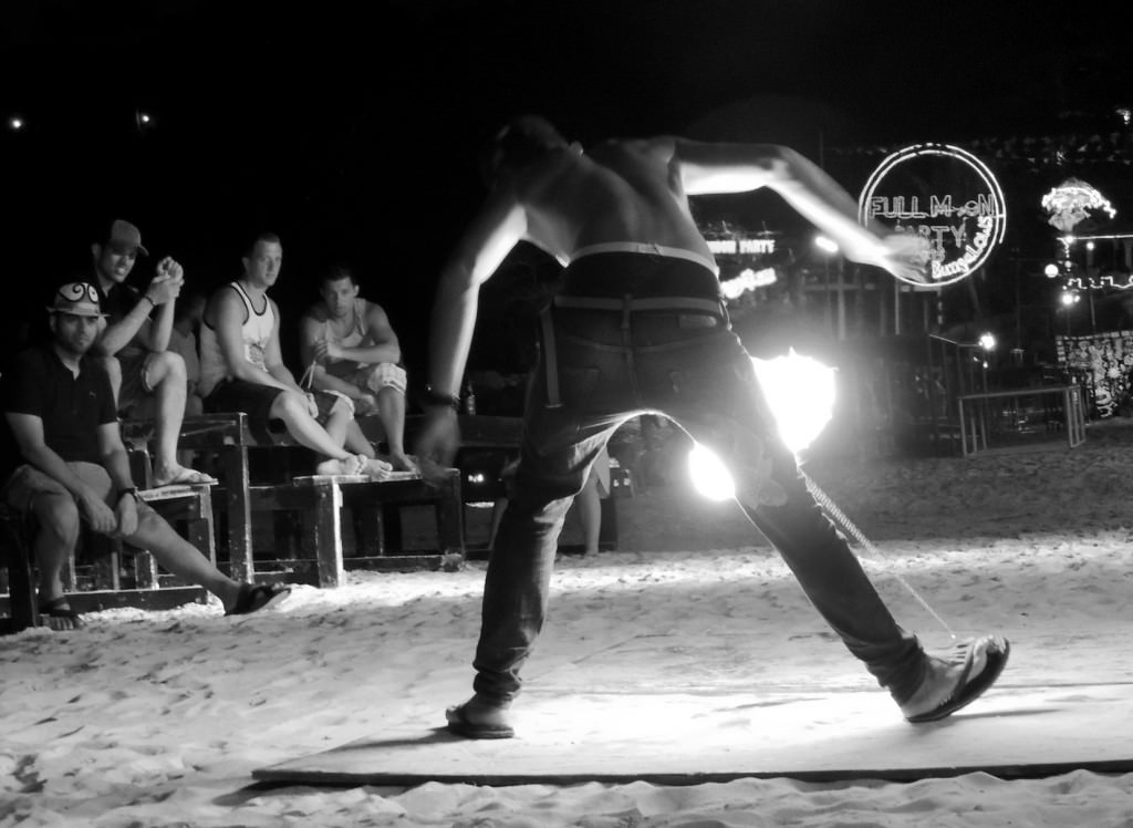My friends and I were on Sunrise Beach near fire jugglers when the offending English guy reappeared.