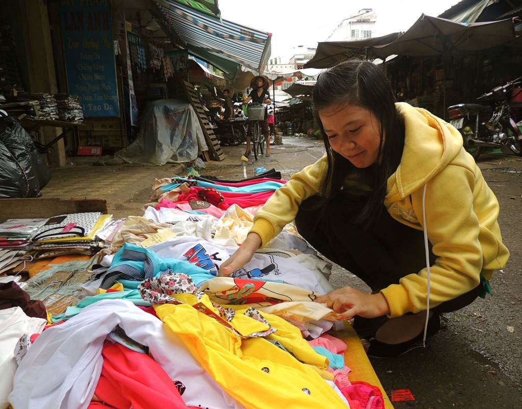 A woman shops in the Tân Bình District of Ho Chi Minh City. She was just as inquisitive about me as I was about her.